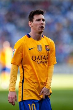 Barcelona's Argentinian forward Lionel Messi stands during the Spanish league football match Malaga CF vs FC Barcelona at La Rosaleda stadium in Malaga on January 23, 2016.