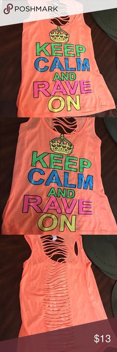 Orange tank top-KEEP CALM AND RAVE ON‼️SALE‼️‼️‼️ Orange tank top ! KEEP CALM AND RAVE ON !slit back !Small black mark in the front as shown in picture !Size M! Good condition ‼️FINAL PRICES NO OFFERS ACCEPTED‼️BUY NOW🎉🎉‼️ Tops Tank Tops