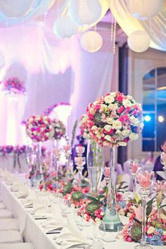 Elegant flower arrangements decorated the table centerpieces at the reception. | www.BridalBook.ph