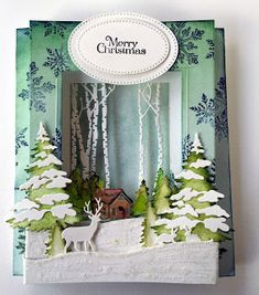 Anita's card using CottageCutz Winter Cabin Border, Birch Trees & Deer, Forest Friends and Snowy Trees dies