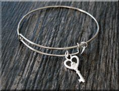 Silver Key Charm Expandable Bangle by charmingpixiejewelry on Etsy