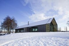 Winter scene of wood barn house on top of hill