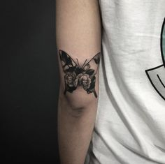 Double exposure floral butterfly tattoo by Pari Corbitt