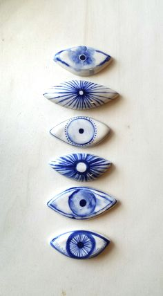 each evil eye is hand painted so each one is slightly different from the last and also one of a kind. we have these 6 designs available - please indicate which eye you would like #1 being the top and #6 the bottom. turn around time is approx. 2 weeks plus shipping time.