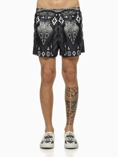 """""""Patagonian"""" beachwear from the S/S2015 Marcelo Burlon County of Milan in black and white."""