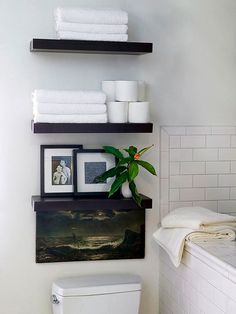 Shelf Satisfaction- stack a trio of clean-lined shelves on the wall above the toilet. It's an easy way to take advantage of vertical wall space and increase storage. Use one shelf to display a few pieces of artwork and use the remaining two to hold short stacks of towels and a few rolls of toilet paper.