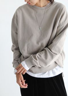 grey sweatshirt, white tee, black bottoms, silver necklace