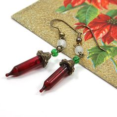 Christmas Earrings Recycled Red Light Dangles from EdytheAnne @Etsy: $10.00. One pair of dangling Christmas light earrings in red, white and green. Great accessory for any Christmas gathering or season celebration. These unique recycled lights will be sure to gather some fun comments. Great affordable gift for friends, co-workers and family members. Please allow one week for delivery.