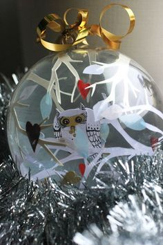 X-mas tree decorations are hand-made items with unique paper-cut inside the ball.