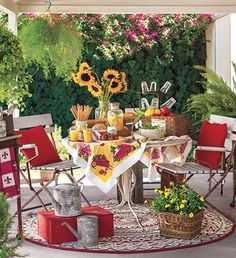 A French country patio with salvage-style furniture and colorful vintage touches