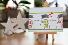 Eine winterliche Valentinskarte oder eine herzige Winterkarte
