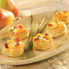 A scrumptious combination of Cheddar cheese, mayonnaise, green onions and crumbled bacon is the perfect filling for golden puff pastry cups. Pop them in the oven for 5 minutes and you've got the perfect party appetizer ready to serve.