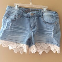 Adorable cut off jeans with lace trim!! The cotton trim on this is just to die for. Looks adorable with cowboy boots or with sandals.  Super comfy denim. Check out my other summer listings, and bundle for discount Wax jeans Shorts Jean Shorts