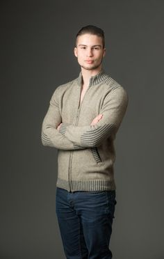 This popular top selling beige men's possum merino jacket is a mid weight knit and has ribbed detailing on the shoulders, elbows, cuffs and pockets. It zips all the way up the front. Knitwear made in New Zealand.