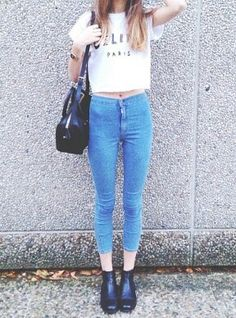 High waisted, light blue pants and withe shirt