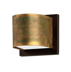 Wall lamps with structure in oxidized brass and optional base in powder coated steel. Available in two sizes in round or square shape. Tempered glass diffuser for direct and indirect light emission. As brass is a natural material, the lampshade might vary in colour, tonality and  pattern from the picture.