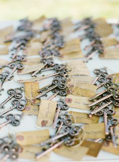 Skeleton Key Bottle Opener with vintage tag by JStarWedding.... These are too cool!