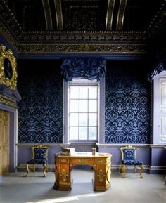 Part I : Blue Velvet Room at Chiswick House, designed by Lord Burlington.   Matching the color of the room and the furniture was a key feature of British Palladianism.  The walls are dual shade velvet.   Over the door is a pulvinated (leaf pattern) and imbricated (ribbon banding) freize. The ceiling is covered in gold motifs of classicism and highly symmetrical.