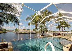 Beautiful pool home in Cape Coral Gulf access Floridaloanoffer@gmail.com 239-689-1331 Cape Coral Real Estate, Beautiful Pools, Opera House, Building, Travel, Viajes, Buildings, Trips, Traveling