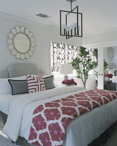 Mirror over headboard, no blanket chest or bench at end, love the color at the foot over white/neutral.