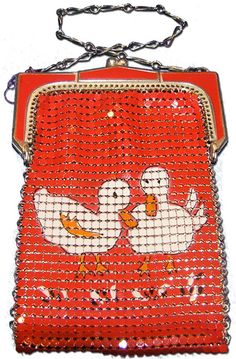 "PurseCollector / Whiting & Davis (not marked) regular flat mesh child's purse with two ducks design on the mesh 3 x 4 1/2. Shirley Temple promoted this purse in the Sears Fall/Winter 1936-1937 catalog where it was advertised for the price of $1.00, which included a mirror with Shirley's photo on the back. The two ducks motif was taken from the appliqued designs on one of Shirley's costumes in the 1935 film ""Curly Top""."