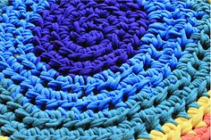 Rainbow rug made from t-shirt yarn, recycle your old t-shirts into something beautiful.