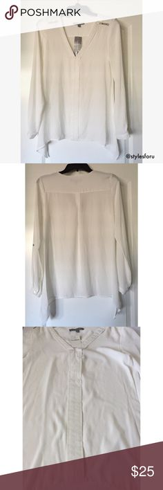 """NWT. White long sleeve blouse NWT. White long sleeve blouse. Shoulder metal detailing. V-neckline. Long pointed sides. Sleeve button. About 26.5"""" long. True to size. Sorry, no trades. Like the item but not the price, feel free to make me a reasonable offer using the offer button. NY Collection Tops Blouses"""
