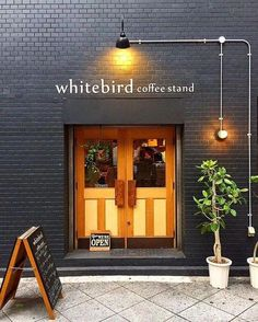 Home Decorators Luxury Vinyl Plank Coffee Shop Design, Cafe Design, Store Design, Cafe Exterior, Exterior Design, Interior And Exterior, Painted Brick Walls, Sign Board Design, Coffee Stands
