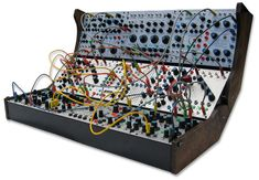 The Buchla 200e is a 21st century rebirth of the 70's classic 200 series analog modular systems from Buchla. It is still an analog synthesizer, but with some 21st century improvements, most notably the addition of MIDI control, patch memory storage and digital hybridization. Other improvements include internal MIDI buses, more voltage controlled parameters, a router for signals and control voltages, velocity sensitivity, and a redesigned output section of the complex oscillator module.