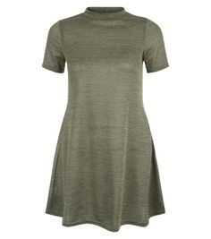 Teens. Make this khaki high neck swing dress a go-to piece for day or night this season.- High neckline- Simple short sleeves- Casual fit- Swing design- Mini length