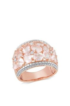 This graceful ring from the Miadora Collection features oval-cut rose quartz gemstones dotted with round white diamonds. The ring is set in rose-plated sterling silver. Gemstone colors: Pink Gemstone