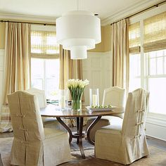 Sleek and Stylish Treatment.  We are in desperate need of stylish window treatments!   This combination of woven shades with flowing curtains that extend the full length of the wall would really give an expansive look to our living space.