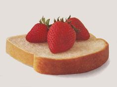 Strawberries on a slice of bread.