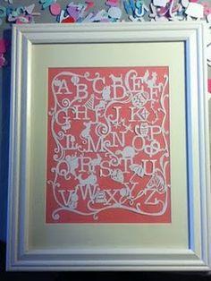 Handmade paper cut alphabet.