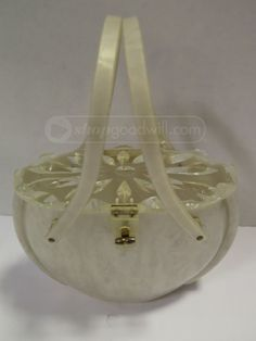 shopgoodwill.com: Vintage Lucite Pearl W/ White Purse Sold for $76