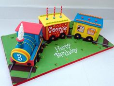 This was a cake was such fun to make – I love using these bright colours and I enjoyed the challenge of working out how to make a realistic 'chassis' platform for the train to sit on. Each of the carriages is a triple layer 6×4×4 inch gooey...