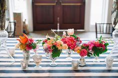 coral charm peony centerpiece with stripes | Joshua Aaron