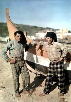 Two men in bare feet stand beside a fishing boat - 1932 Photographer:W. Folk Costume, Costumes, Nostalgic Pictures, Beauty Around The World, Photo P, Portuguese, National Geographic, Foto E Video, Barefoot