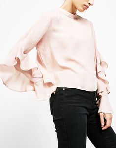 High neck blouse with frilled sleeves. Discover this and many more items in Bershka with new products every week