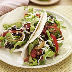 Black beans make a hearty stand-in for ground beef in these vegetarian tacos — especially when they're gussied up with all your favorite toppings! Recipe: Vegetarian Tacos   - Delish.com