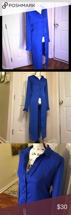 Beautiful long tunic top - Royal blue NWT! This long tunic is absolutely gorgeous. With a button down closure to waist in front, it's perfect for work or more casual with jeans/leggings! Belt it up or let it flow. Very flowy at bottom. 100% polyester but feels like silk! Ultra luxury without the hassle. Never worn, and comes with original packaging from Stylewe. Designed by Lantian, sold by STYLEWE. Size is XL but could also fit L. Slots on sides for extra breath ability and flow. Gorgeous…