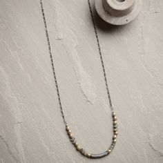 """Ronda Smith Designs """"Victoria 65"""" Long Necklace-Handmade with gunmetal chain, silver metal beads, labradorite beads, and CZ tube."""