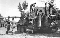 wehrmachtinternetmuseum:  Tiger crew taking a look at their tanks engine. Notice the engine deck is open.