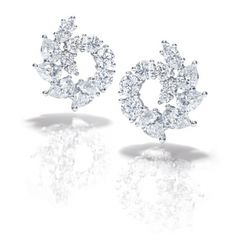 Marquise and pear-shaped diamonds make up these garland diamond earrings set in platinum from Harry Winston.