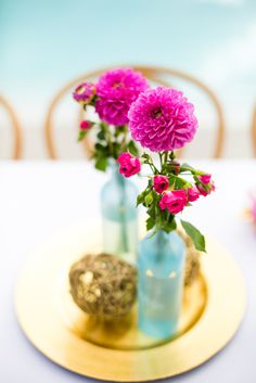 Centerpieces with Pink Ranunculus | M & E Photo Studio https://www.theknot.com/marketplace/m-and-e-photo-studio-kansas-city-mo-660251
