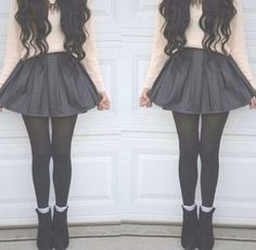 Cute sweater and skirt combo.