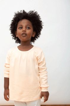 organic cotton long sleeve t-shirt in peach. Sizes 12 mos to youth 8.