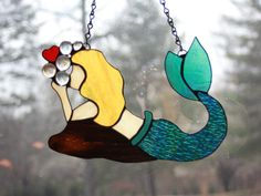 Hey, I found this really awesome Etsy listing at https://www.etsy.com/listing/516270639/mermaid-kisses-suncatcher