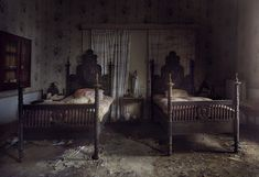 A vast abandoned manor house, interior -andre govia Oh my....what gorgeous beds!!! How can these beautiful pieces be abandoned????