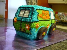 Mystery Machine cake decorated with star tips; wheels made from frosted oreos; this would be cute with Scooby-character-themed cupcakes alongside it.